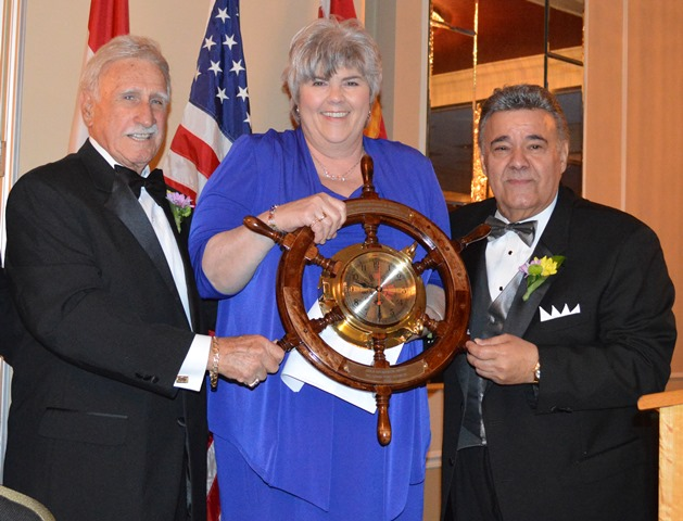During the 2013 St. Louis PMC Dinner, State Senator Gina Walsh receives the Able Helmsmen Award from PMC Pres Richard Mantia (left) and MTD Pres Michael Sacco.