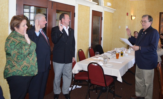 From left, Becky Sleeper, Jack Martorelli and John Stiffler are sworn in as St. Louis PMC officers by MTD Exec Sec-Treas Daniel Duncan.