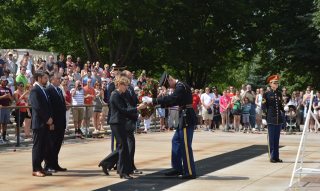 """Pam Donato and Eric Packard present """"No Greater Love"""" wreath to Honor Guard at the Tomb of the Unknowns at Arlington Cemetery on Memorial Day. Behind them are Will Fischer and Daniel Duncan."""