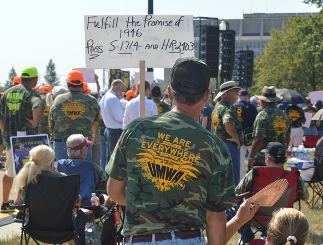 A hard-written sign shows what the Mine Worker and others want Congress to enact.