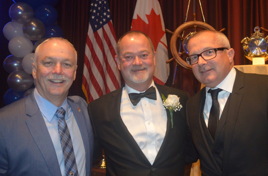 Congratulating Paul Hall Awardee Jim Given (center) are The Lower Great Lakes and Tributaries Port Council of Canada President John McCann (left) and St. Lawrence and Tributaries Port Council of the Province of Quebec President Albert Batten.